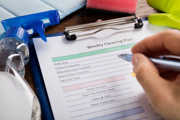 A cleaning schedule being filled out ensuring the entire home is clean